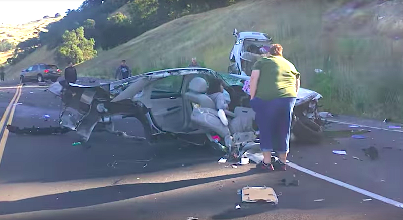 Auto  split down middle after crash - and driver SURVIVED