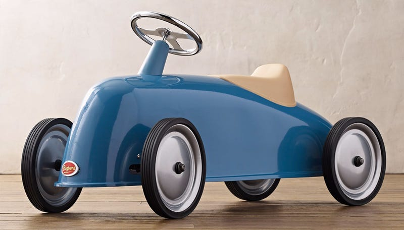 Illustration for article titled The Sleek Lines of this Ride-on Roadster Is the Best Reason to Have Kids