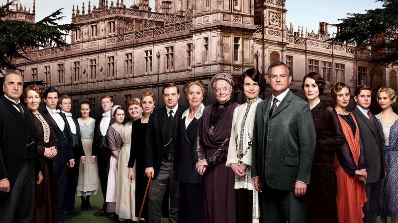 Queen Elizabeth II pores over this photo of the Downton Abbey cast, searching every pixel for errors