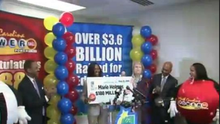 Marie Holmes is shown holding a $188 million check—her share of the $564 million Powerball jackpot—in February 2015. Things haven't gone so smoothly for the single mother of four since then.My News 2 screenshot