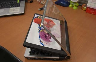 Illustration for article titled Everex CloudBook's Old-School Answer to Digital Photo Frames
