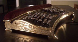 Illustration for article titled Datamancer Ergo Steampunk Keyboard Makes Writing Victorian Fanfics Slightly Less Uncomfortable