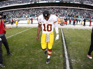 Quarterback Robert Griffin III of the Washington Redskins walks off the field after the team's 24-16 loss to the Philadelphia Eagles at Lincoln Financial Field on Nov. 17, 2013, in Philadelphia.Rob Carr/Getty Images