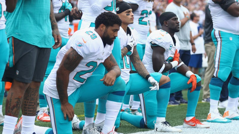 Arian Foster #29, Kenny Stills #10 and Michael Thomas #31 of the Miami Dolphins making a political statement, just like everyone who remained standing or complained about any of the above was making a political statement. Photo by Maddie Meyer/Getty Images.