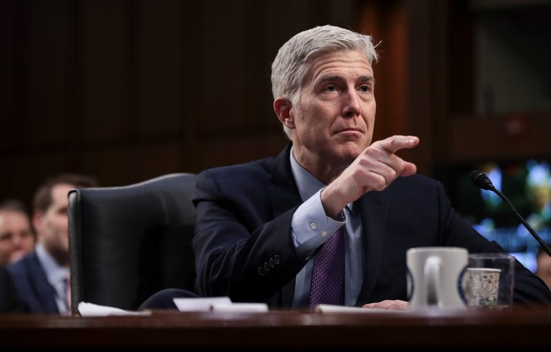 Judge Neil Gorsuch presumably points at all the women he's going to prohibit from having abortions after he helps overturn Roe v Wade (Photo by Drew Angerer/Getty Images)