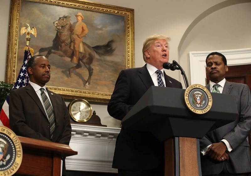 President Donald Trump speaks while flanked by HUD Secretary Ben Carson and Isaac Newton Farris Jr. before signing a proclamation to honor Martin Luther King Jr. Day in the Roosevelt Room at the White House on Jan. 12, 2018, in Washington, DC. (Mark Wilson/Getty Images)