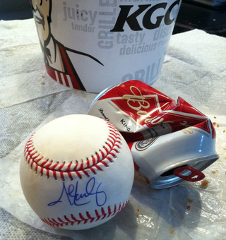 Illustration for article titled Someone's Selling A John Lackey Signed Ball Stained With Chicken Grease