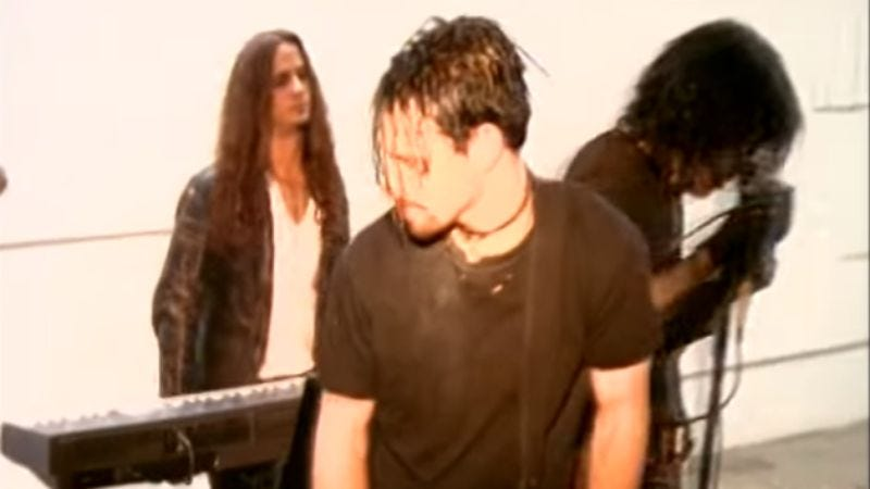 """Woolley (left) in the video for Nine Inch Nails' """"March Of The Pigs"""""""