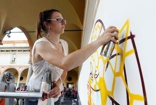 Illustration for article titled Italian Graffiti Artist Decks The Halls