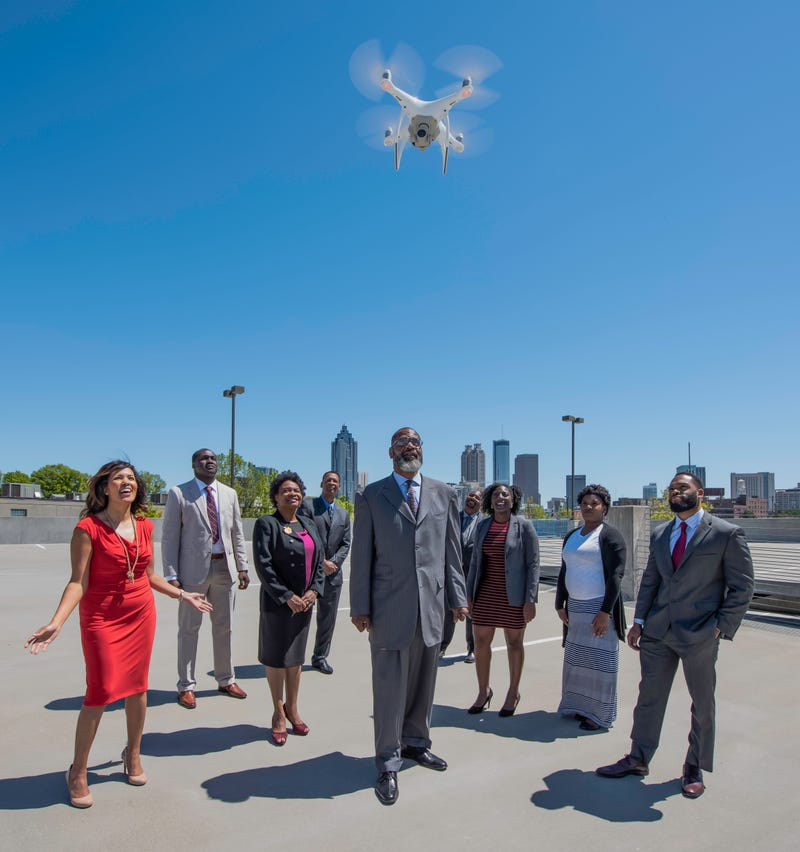 Drone entrepreneur Terrance X. Johnson (center, foreground)) with members of his team at TCJ AeroTech (Tony Ellis/Tony Ellis Media)