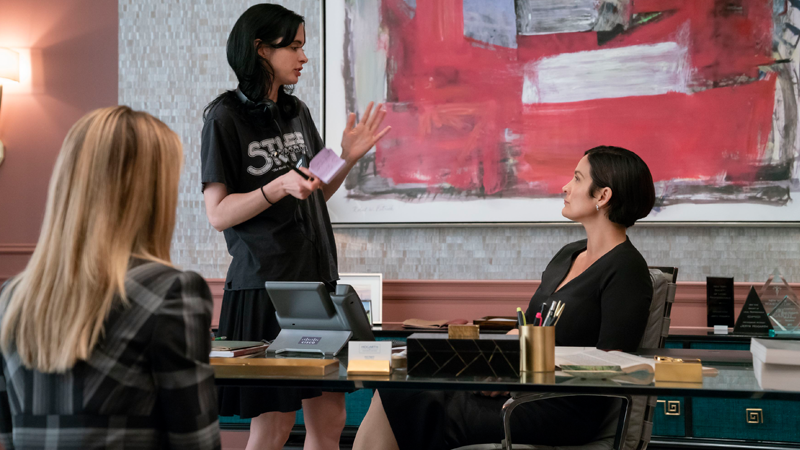 Krysten Ritter offers notes to Carrie-Anne Moss in a new behind-the-scenes still from Jessica Jones' final season.