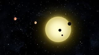 Illustration for article titled Astronomers find five planets packed into a ridiculously tight orbit around the same star