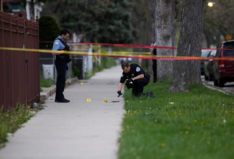 Police work to find evidence at the scene of a fatal shooting of a 16-year-old boy and the wounding of an 18-year-old man in Chicago on April 25, 2016.Joshua Lott/Getty Images