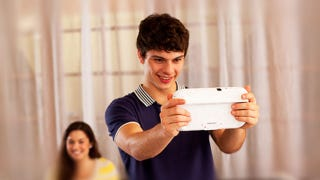 Illustration for article titled It's Time for Pictures of People Looking Like Idiots Playing the Wii U