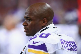 Adrian Peterson of the Minnesota Vikings on the sidelines in a September game, before he was suspended from the teamDilip Vishwanat/Getty Images