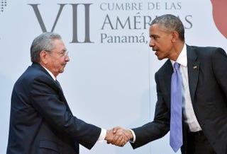 Cuban President Raúl Castro shakes hands with President Barack Obama during a meeting on the sidelines of the Summit of the Americas at the Atlapa Convention Center April 11, 2015, in Panama City. MANDEL NGAN/AFP/Getty Images