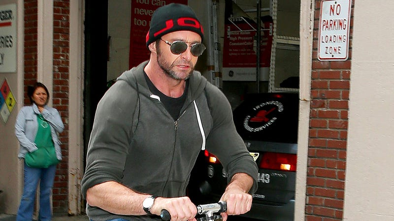 Illustration for article titled Hugh Jackman Rides Scooter on NYC Sidewalk, Confuzzles Bystander