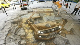 Illustration for article titled See a chalk pickup truck burst through the sidewalk