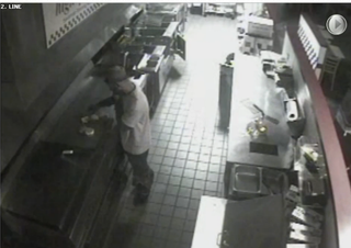 Video footage of a burglary suspect March 18, 2016, as he grills food for himself inside a Washington, D.C., Five Guys restaurant that was closed for the eveningKHOU