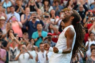 Germany's Dustin Brown celebrates beating Spain's Rafael Nadal during their men's singles second-round match on day 4 of the 2015 Wimbledon Championships in London July 2, 2015. Brown won 7-5, 3-6, 6-4, 6-4. GLYN KIRK/AFP/Getty Images