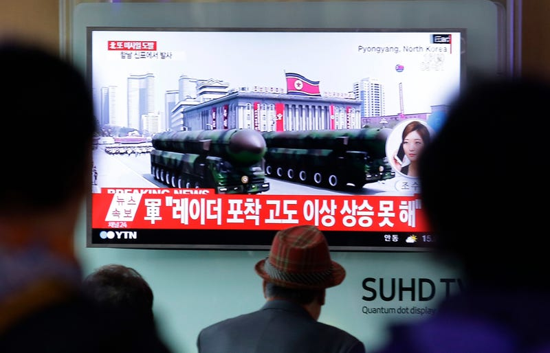 """People watch a live television program showing North Korea's missiles with letters reading """"Pukguksong"""" during a parade in Pyongyang, North Korea, at the Seoul train station in Seoul, South Korea, Saturday, April 15, 2017. AP Photo"""