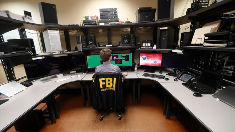 An FBI agent working in a cyber forensics lab in New Orleans.