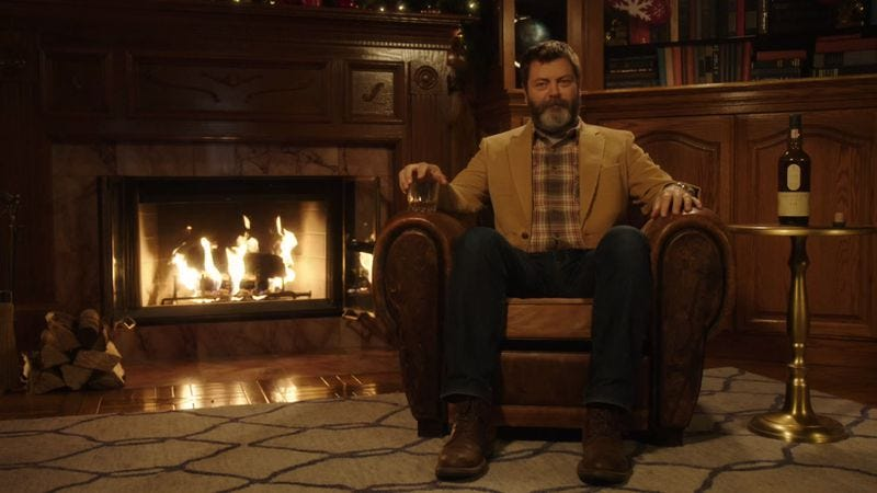 Illustration for article titled Here's 45 minutes of Nick Offerman drinking whisky in front of a fire