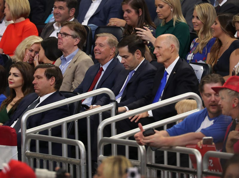 Florida Gov. Ron DeSantis (front row) Lindsey Graham (R-SC), Sen. Marco Rubio (R-FL) and Sen. Rick Scott (R-FL) listen as U.S. President Donald Trump announces his candidacy for a second presidential term on June 18, 2019 in Orlando, Florida.