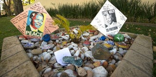 Messages for Nelson Mandela outside his Johannesburg home during his recent hospital stay (Alexander Joe/AFP/Getty Images)