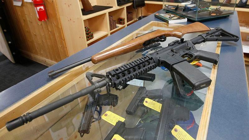Multiple guns on a table.