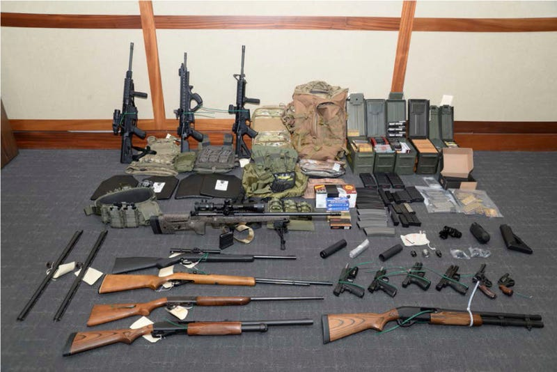"This image provided by the U.S. District Court in Maryland shows a photo of firearms and ammunition that was in the motion for detention pending trial in the case against Christopher Paul Hasson. Prosecutors say that Hasson, a Coast Guard lieutenant is a ""domestic terrorist"" who wrote about biological attacks and had a hit list that included prominent Democrats and media figures."