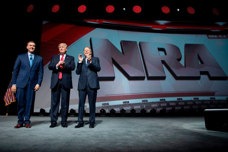 President Donald Trump (center) stands with National Rifle Association President Wayne LaPierre (right) and NRA-ILos Angeles Executive Director Chris Cox during the NRA Leadership Forum in Atlanta April 28, 2017. (Jim Watson/AFP/Getty Images)