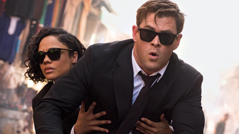 A crop from EW's new cover story—Agent M holding Agent H for dear life.
