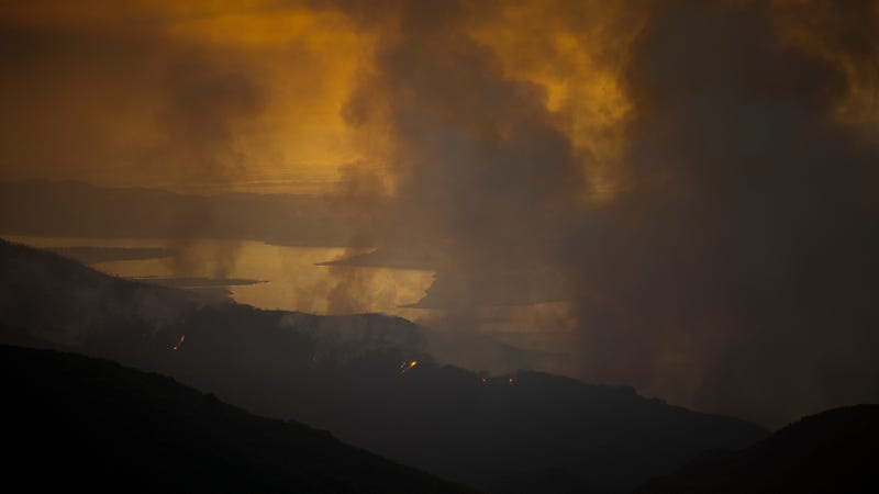 A wildfire burns next to Lake Cachuma on July 9, 2017 near Santa Barbara, California. Image via Getty.