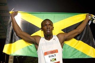 Usain Bolt with the Jamaican flagAmy Inita Joyner-Francis