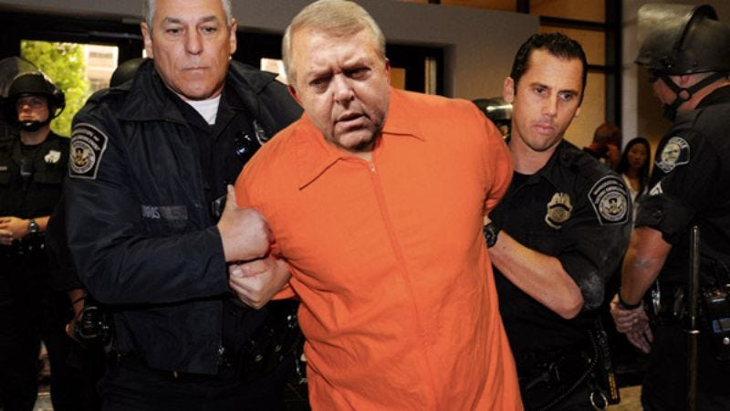 """Luis Miguel Salvador Aguila Dominguez, alias """"Lou Dobbs,"""" is escorted by DHS agents to the airport to be sent back to Mexico."""