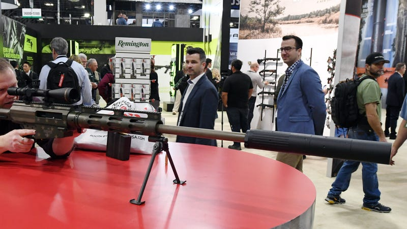 A man looks at a Bushmaster BA-50 bolt-action rifle at the Remington booth at the 2018 National Shooting Sports Foundation's Shooting, Hunting, Outdoor Trade Show at the Sands Expo and Convention Center on Jan. 23, 2018, in Las Vegas.