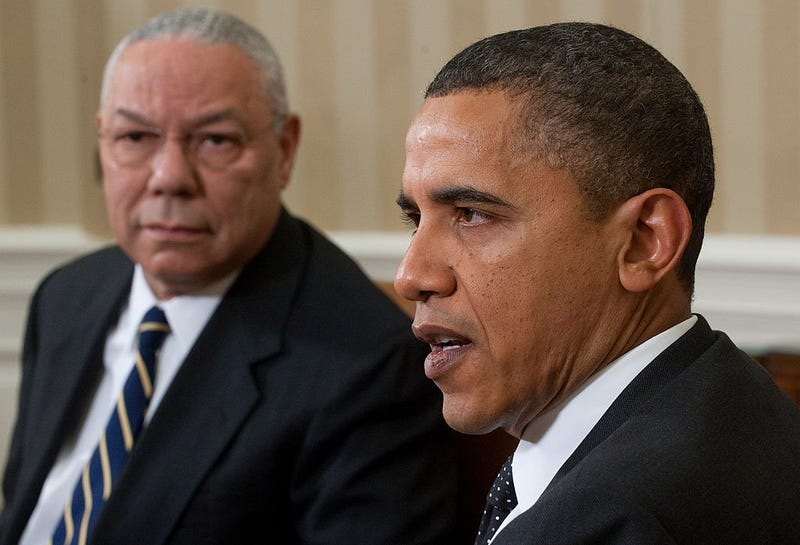 President Barack Obama (right) speaks alongside former Secretary of State Gen. Colin Powell during a meeting in the Oval Office of the White House in Washington, D.C., Dec. 1, 2010. SAUL LOEB/AFP/Getty Images
