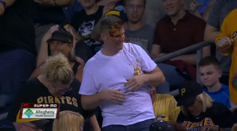 Illustration for article titled Pirates Fan Leaps For Foul Ball, Comes Up With A Face Full Of Nacho Cheese