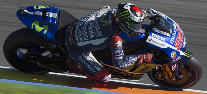 Illustration for article titled Lorenzo Grabs Pole With Record Time, Rossi Crashes In MotoGP Finale Qualifying