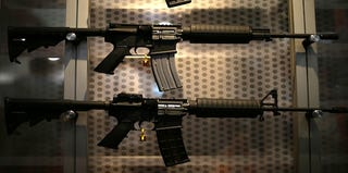 Assault rifles like these were found at Richard Schmidt's house. (Justin Sullivan/Getty Images)