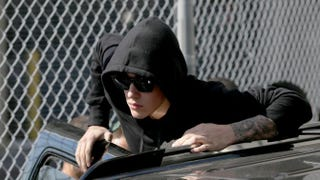 Justin Bieber prepares to stand on his vehicle after exiting from the Turner Guilford Knight Correctional Center on Jan. 23, 2014, in Miami.Joe Raedle/Getty Images