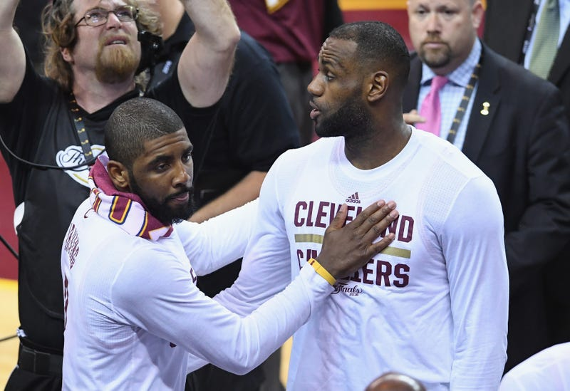 68b4ad2b9169 Kyrie Irving of the Cleveland Cavaliers celebrates with LeBron James after  defeating the Golden State Warriors