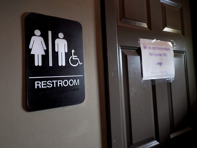 Unisex signage appears outside a bathroom at Bull McCabes Irish Pub in Durham, N.C., on May 10, 2016.Sara D. Davis/Getty Images