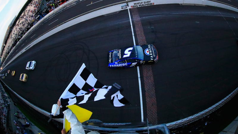 Kasey Kahne takes the checkered and yellow flag at the same time to win the Brickyard 400, because everything is terrible and races shouldn't finish under green. Photo credit: Dan Shirey/Getty Images