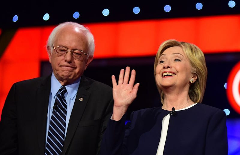 Presidential hopeful Hillary Clinton (right) gestures while standing beside Bernie Sanders during the first Democratic presidential debate in Las Vegas on Oct. 13, 2015. FREDERIC J. BROWN/AFP/Getty Images