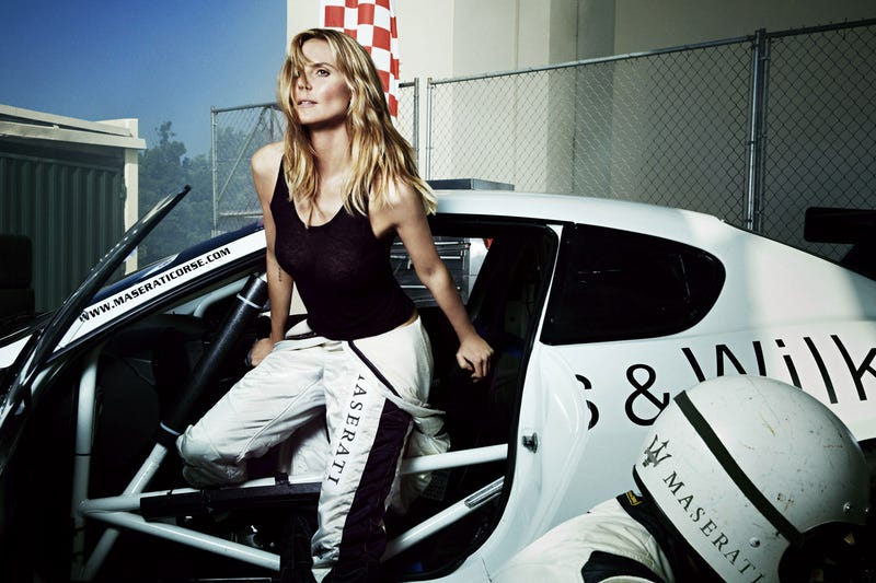 Illustration for article titled Heidi Klum Proves You Can Look Good Getting Out Of A Race Car