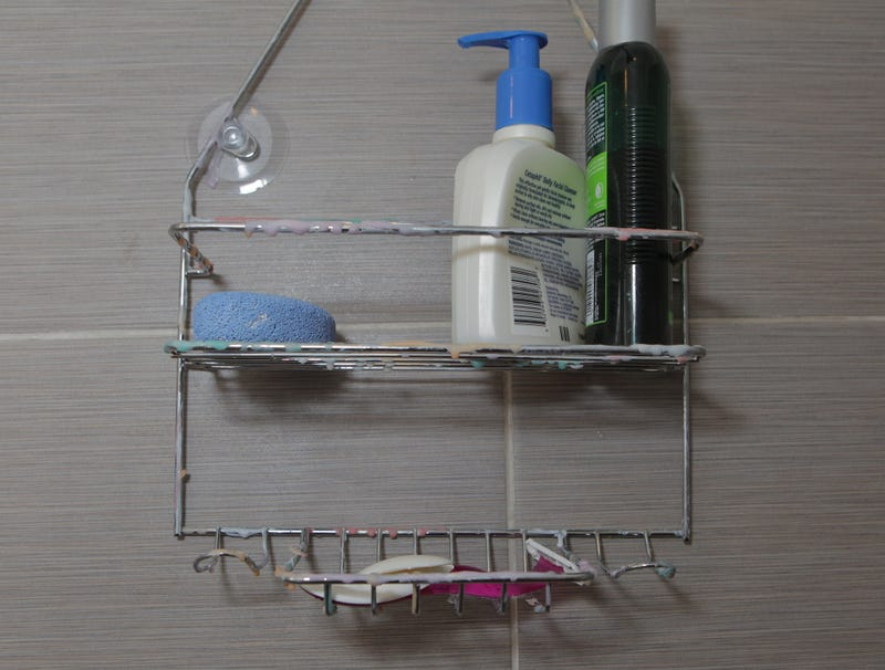 Illustration for article titled Shower Caddy Coated In Dazzling Multicolor Array Of Various Soap Films