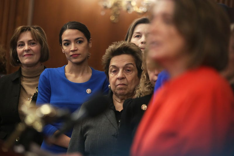 Rep. Kathy Castor (D-FL), left, Rep. Alexandria Ocasio-Cortez (D-NY), and Rep. Donna Shalala (D-FL) listen as Speaker of the House Rep. Nancy Pelosi (D-CA) speaks during a news conference at the U.S. Capitol January 30, 2019 in Washington, D.C.