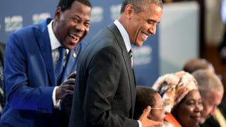 """President Boni Yayi of Benin laughs with President Barack Obama as they arrive at """"Session 3: Governing the Next Generation"""" at the U.S.-Africa Leaders Summit in Washington, D.C., Aug. 6, 2014.Jim Watson/Getty Images"""
